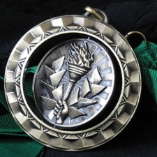 spinning-olympic-torch-medal